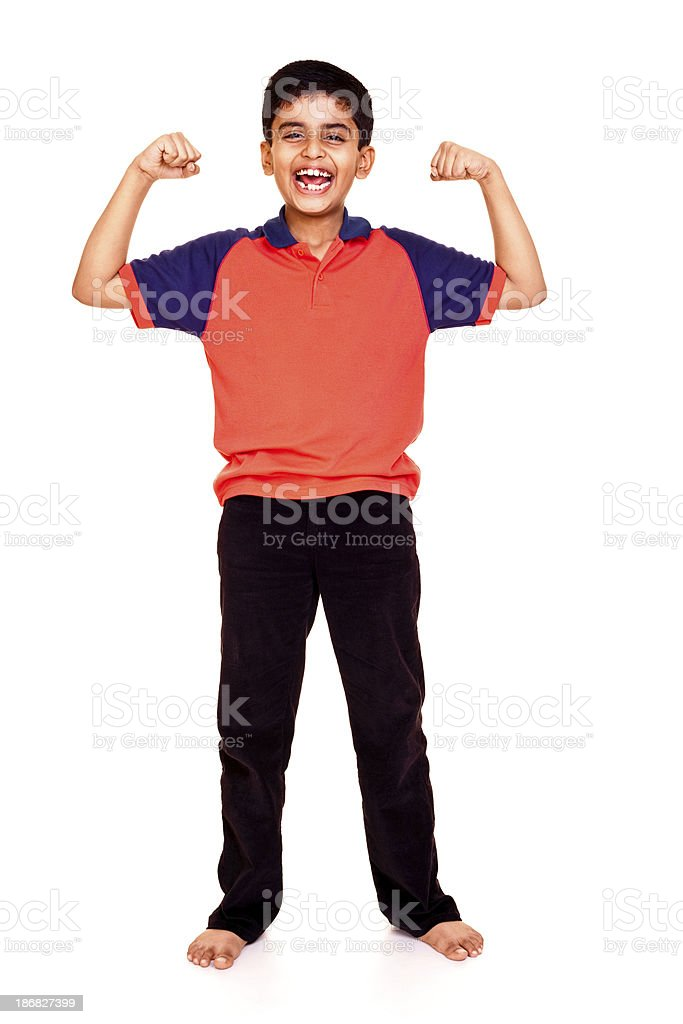 Isolated Indian Boy Standing Smiling Showing Muscle Full Length royalty-free stock photo
