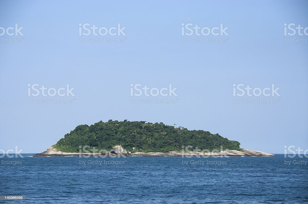 Isolated island in the ocean royalty-free stock photo