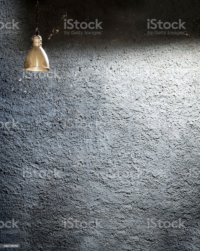 Isolated lamp against granite wall stock photo