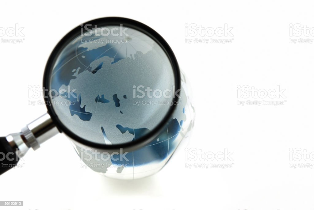 Isolated magnified glass globe royalty-free stock photo