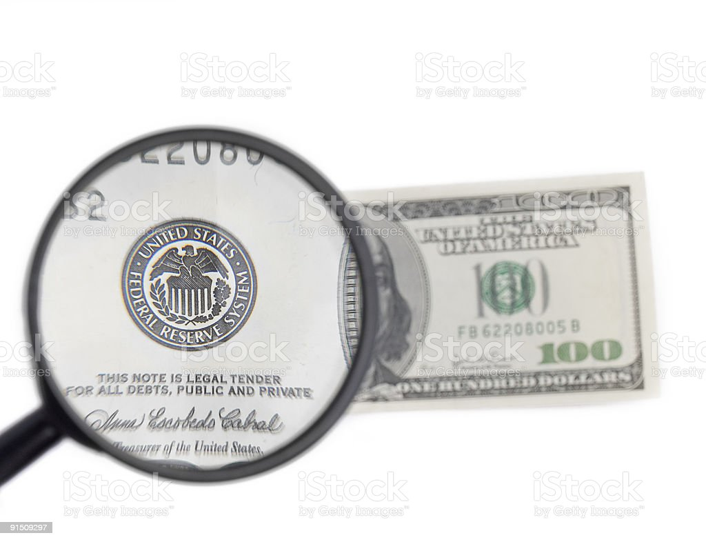 isolated magnifier with dollars royalty-free stock photo