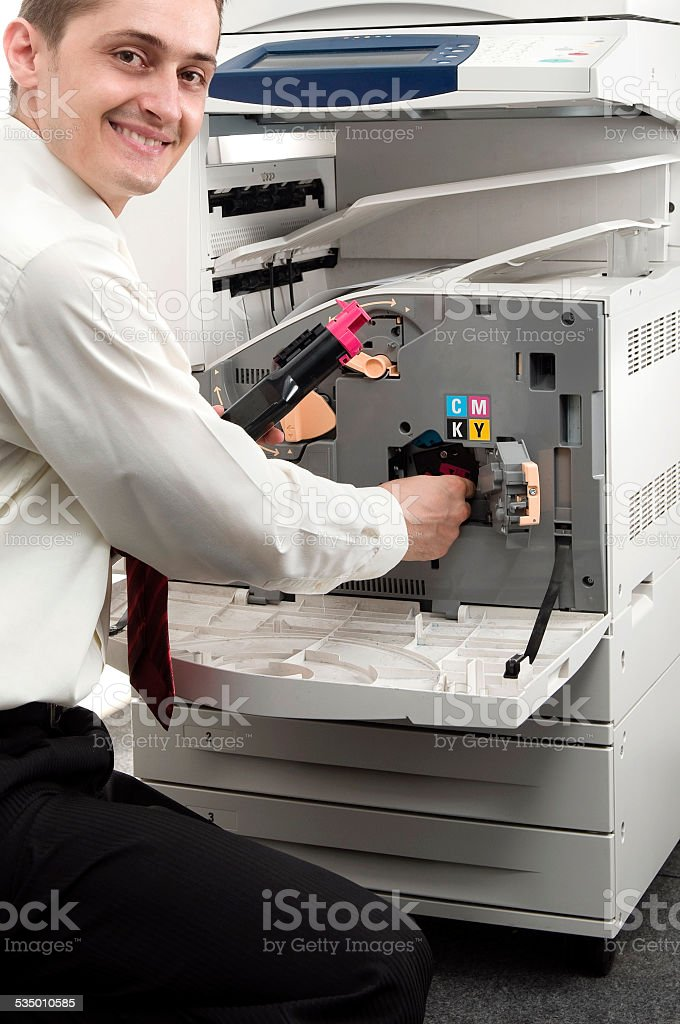 Isolated man and office printer stock photo