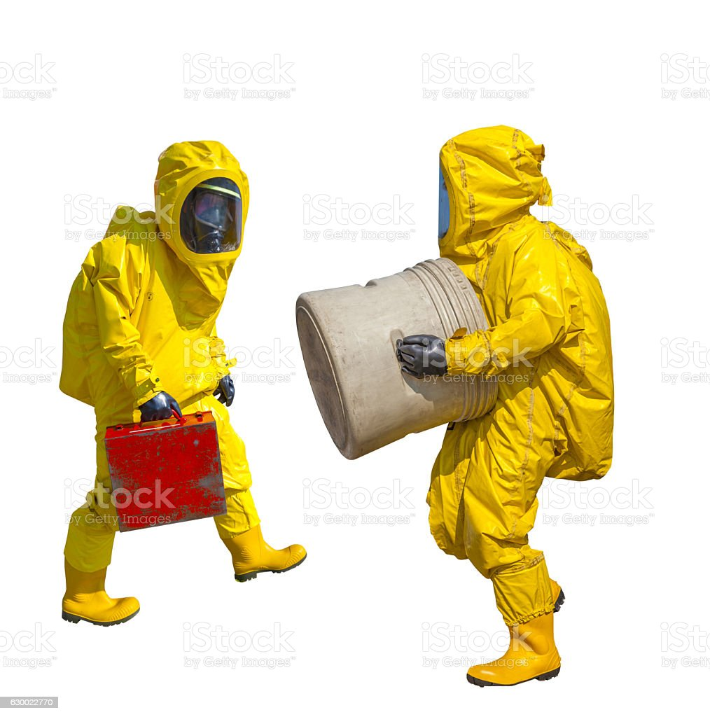 Isolated man in yellow protective hazmat suit stock photo