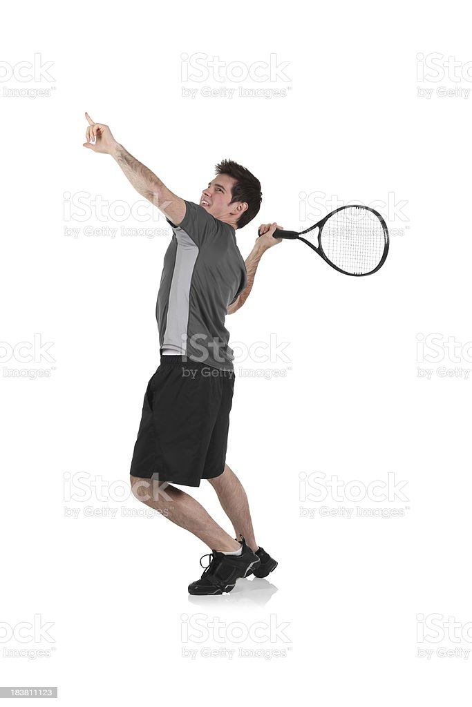 Isolated man playing tennis royalty-free stock photo