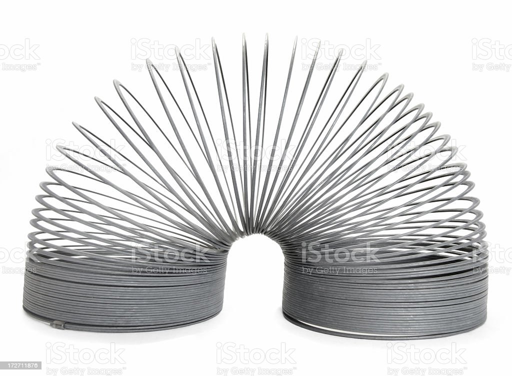 Isolated metal slinky toy on a white background royalty-free stock photo