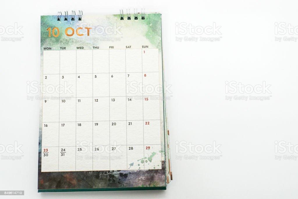 isolated mock up October creative design calendar on office desk stock photo