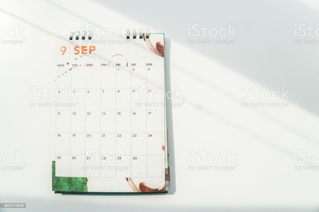 isolated mock up September calendar on table with sunlight in the morning stock photo