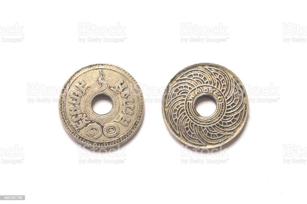 isolated of 1937 old Thai coin on white background stock photo