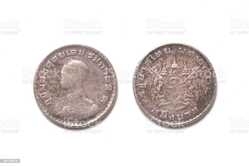 isolated of 1962 old Thai coin on white background stock photo