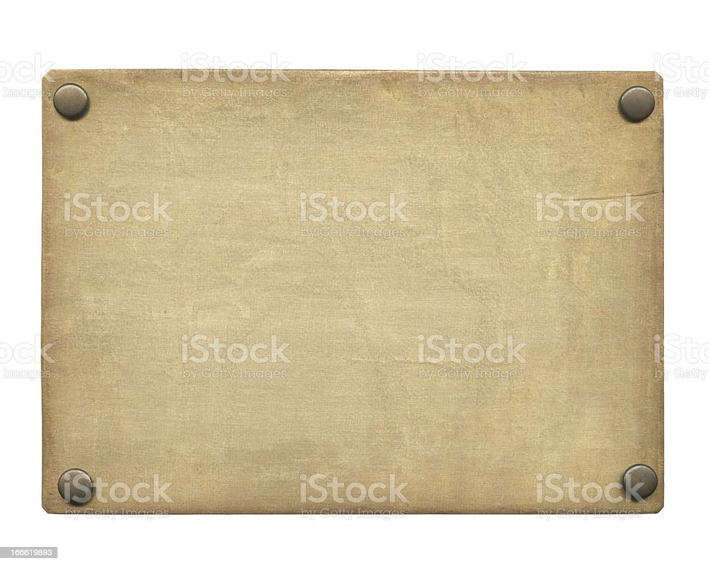 Isolated old brass plate against a white background stock photo