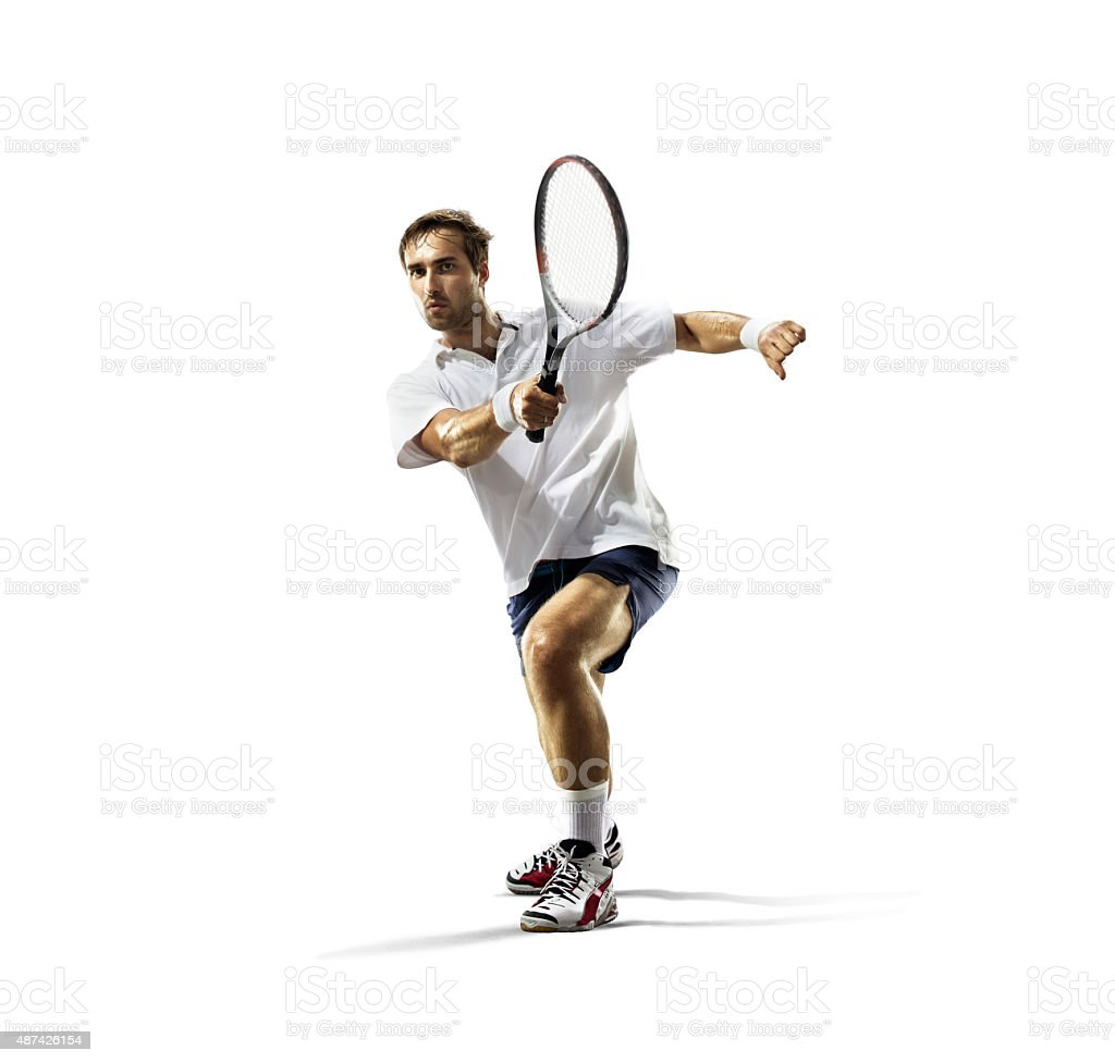 isolated on white young man is playing tennis stock photo