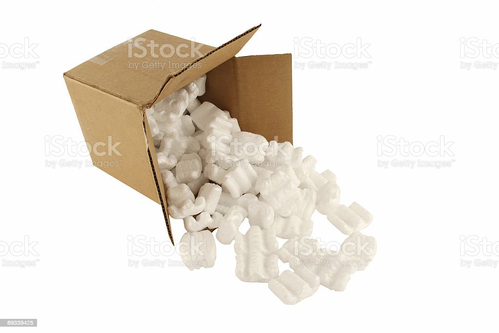 Isolated open cardboard box with spilled packing peanuts stock photo