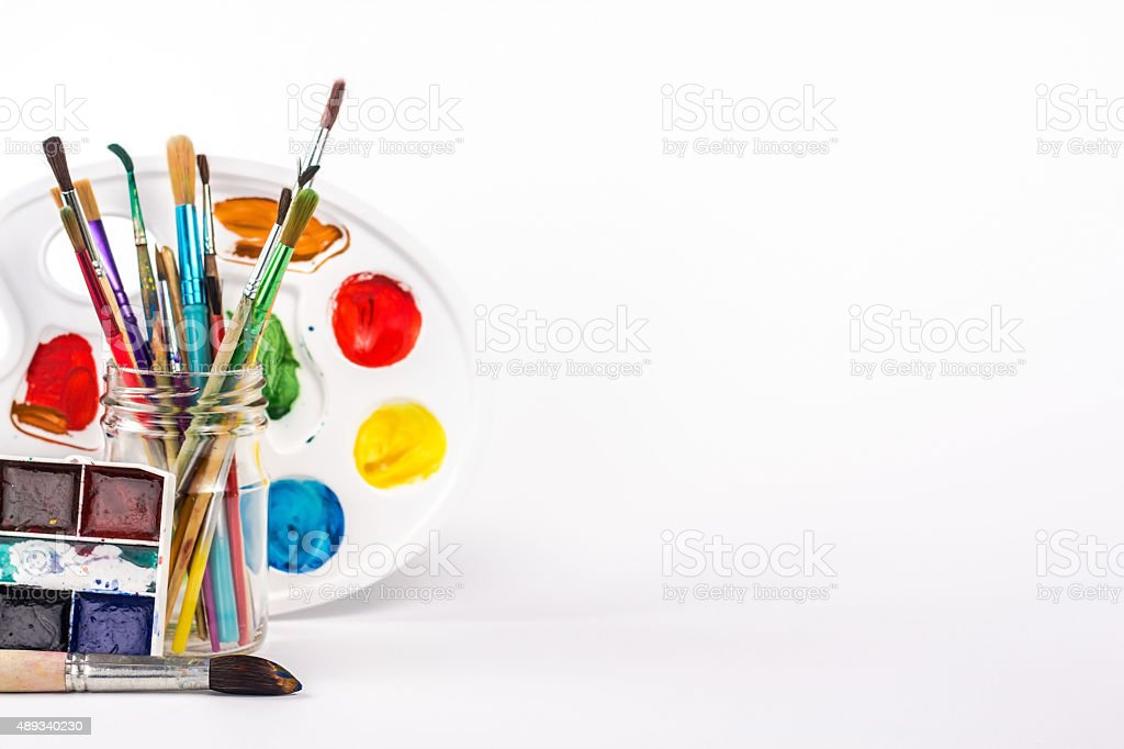 isolated paints brushes, watercolour and paints palette stock photo
