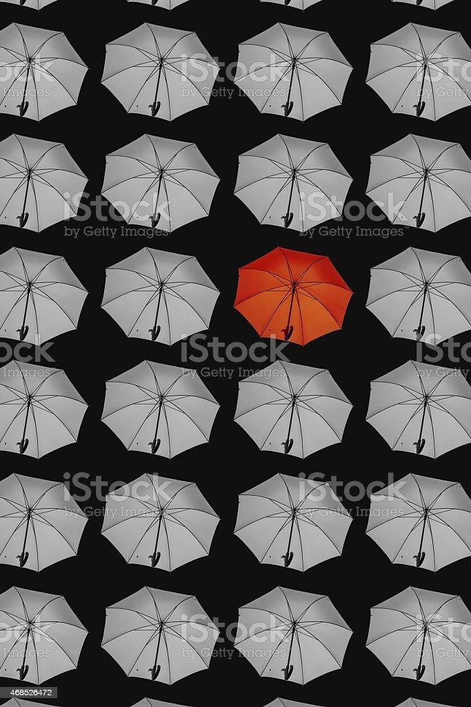 Isolated pattern of umbrellas on black background stock photo