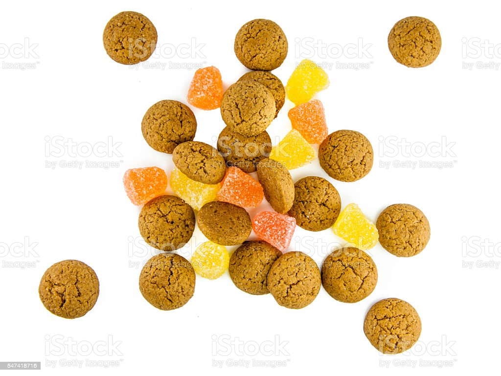 Isolated pepernoten and sweets on a pile stock photo