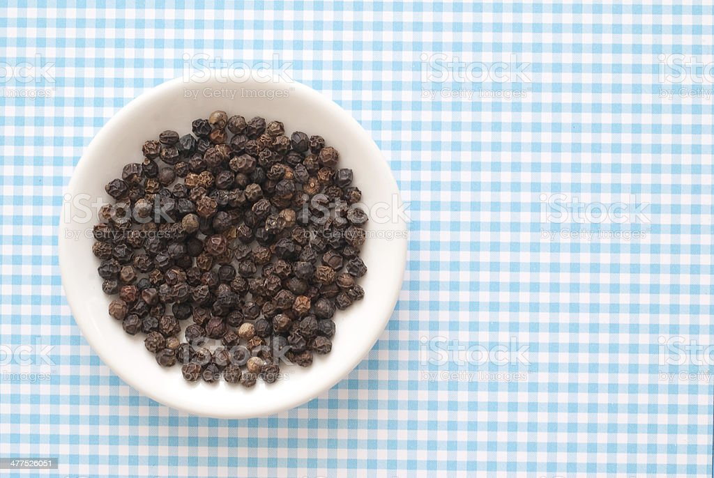 isolated Pepper Corns on blue serenity checkered background stock photo