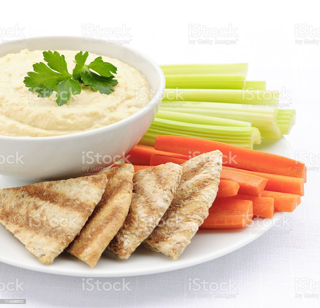 Isolated photo of a plate of vegetables hummus and pita stock photo
