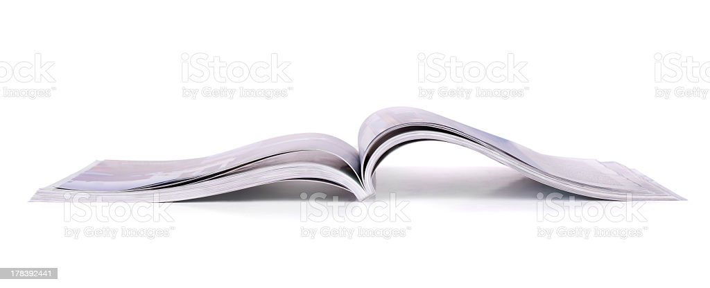 Isolated picture of an open magazine royalty-free stock photo