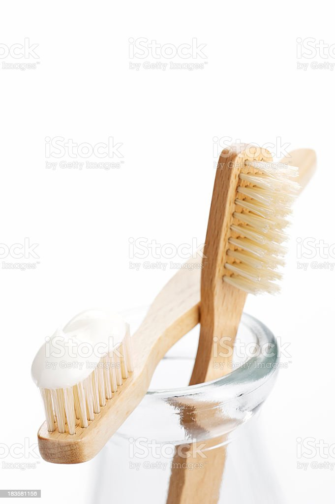 Isolated picture of toothbrushes on a jar stock photo