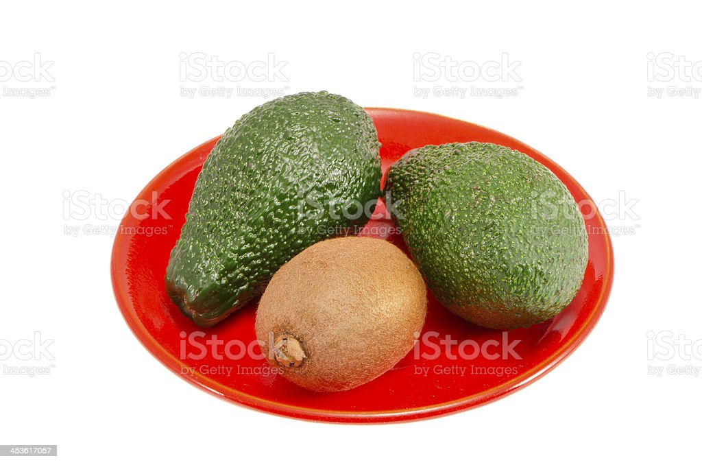 isolated plate with avocado and kiwi fruit royalty-free stock photo