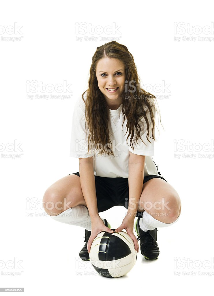 Isolated portrait of a female soccer player with a ball royalty-free stock photo