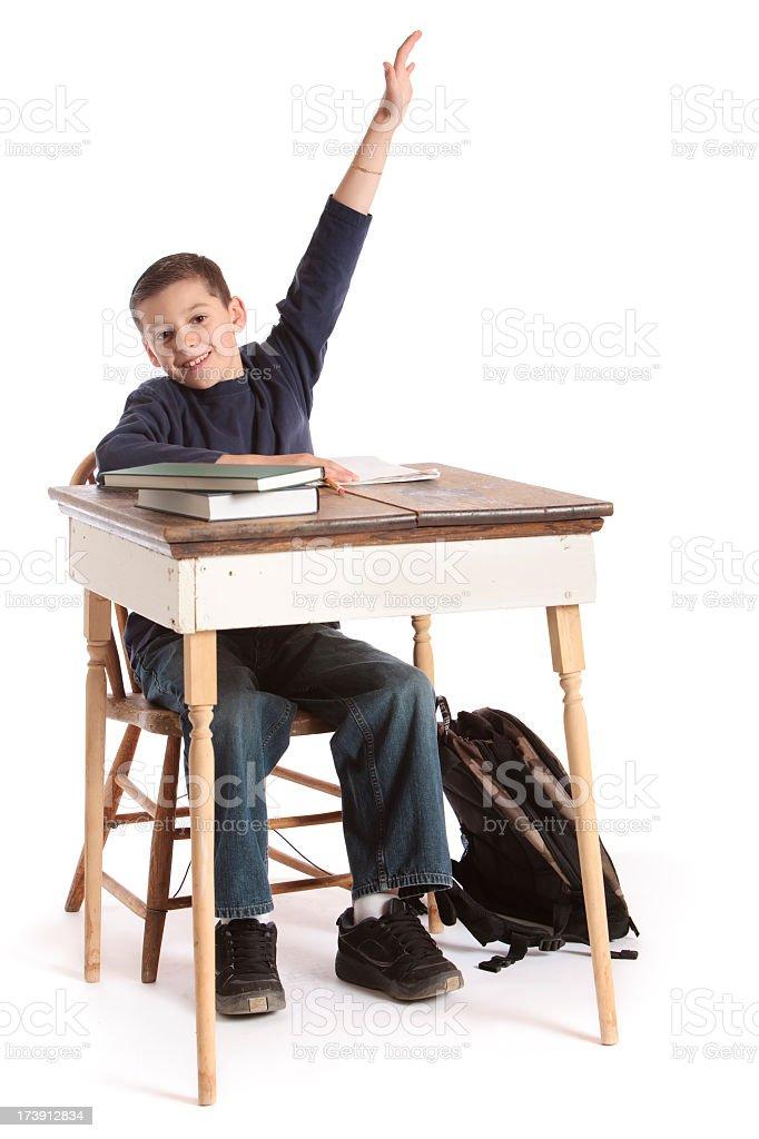 Elementary Student Sitting At Desk