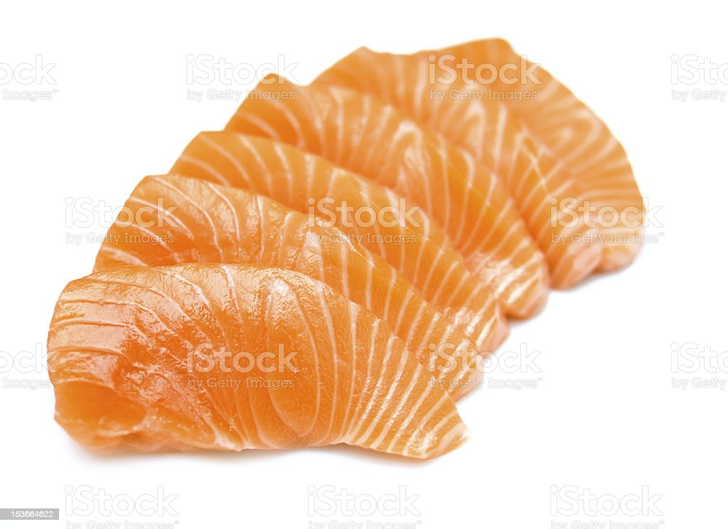 Isolated raw sliced salmon stock photo