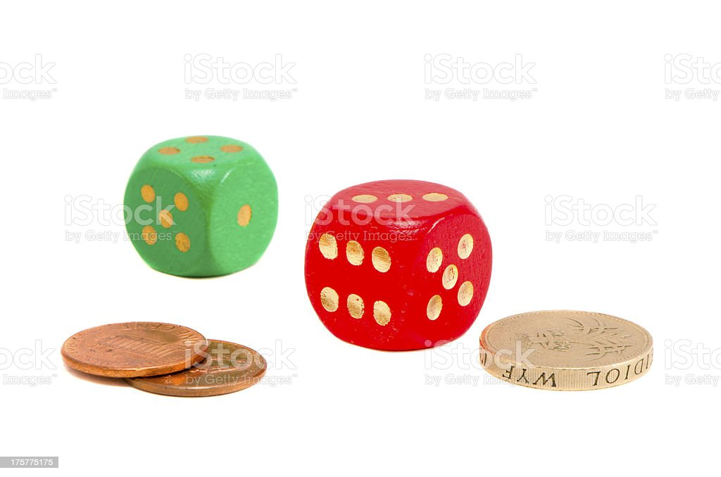 isolated red and green dices with coins royalty-free stock photo