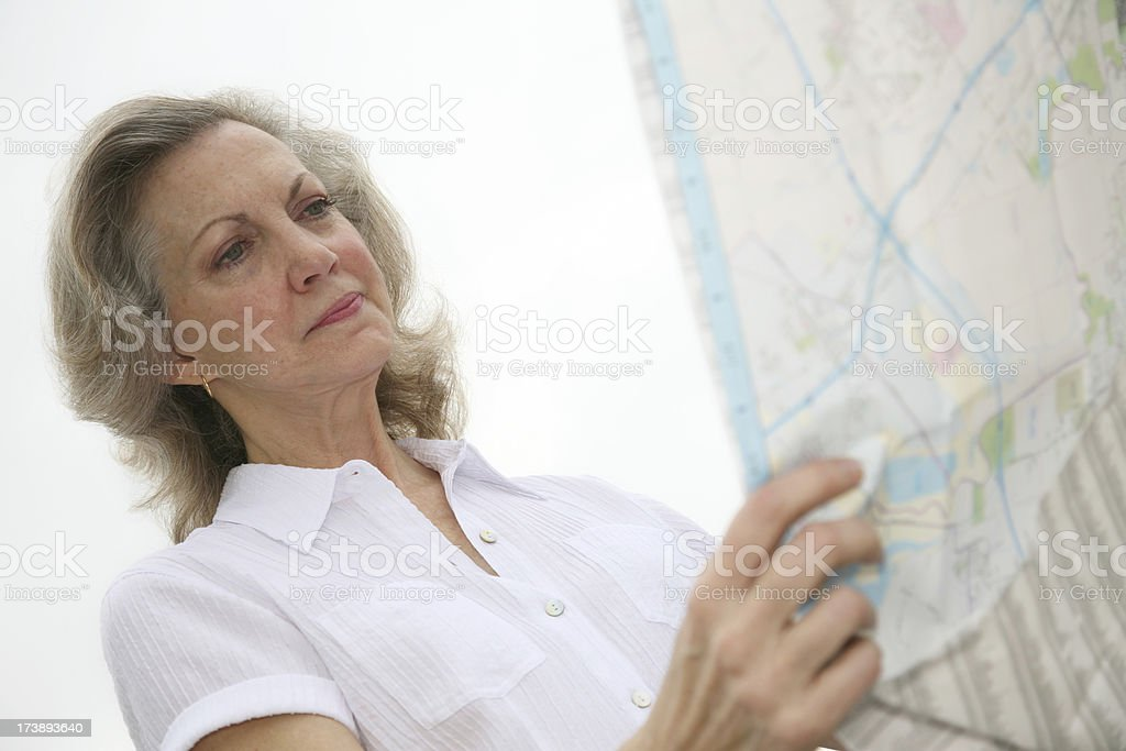 Isolated Senior Adult Woman Looking at a Map royalty-free stock photo
