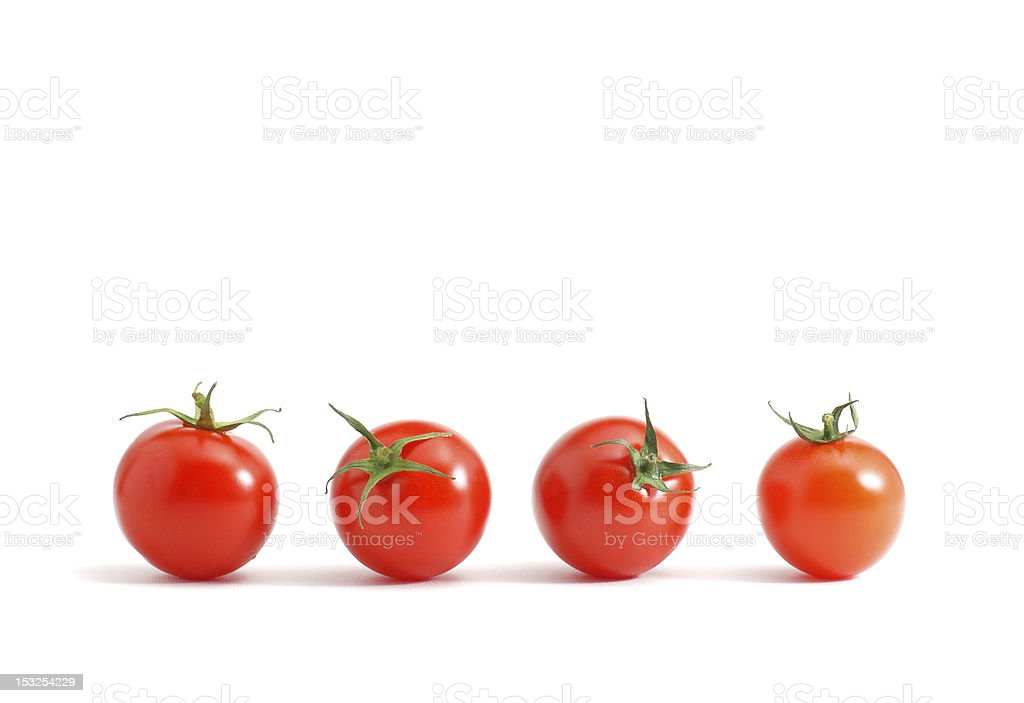 Isolated set of cherry tomatoes organized in a row stock photo
