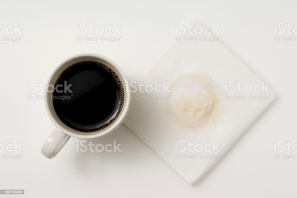 Isolated shot of a cup of coffee with napkin stock photo