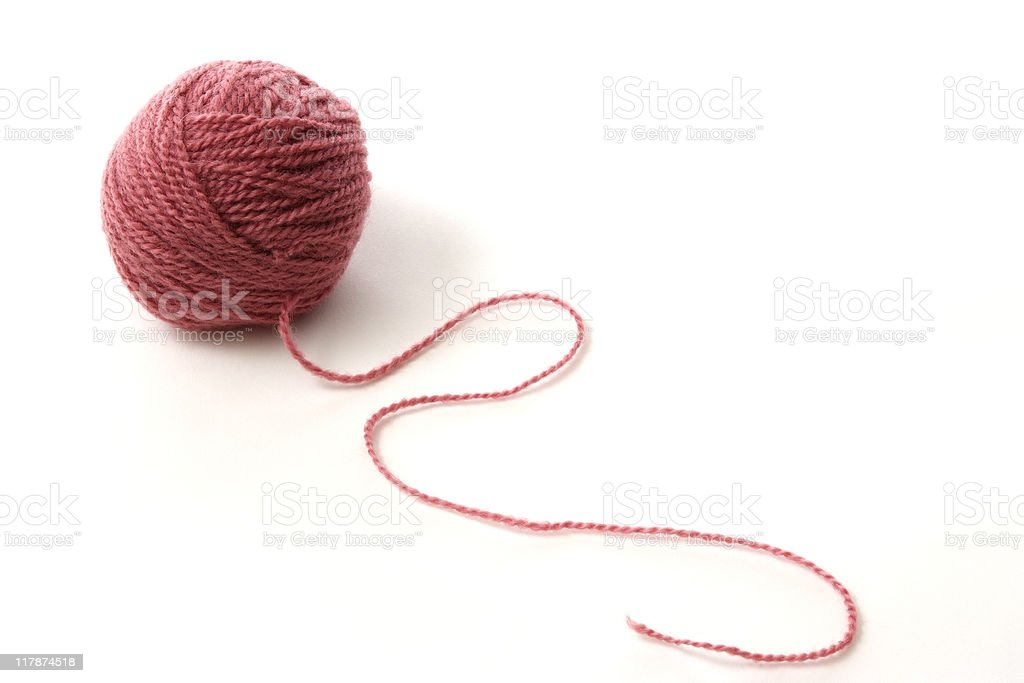 Isolated shot of ball of wool on white background stock photo