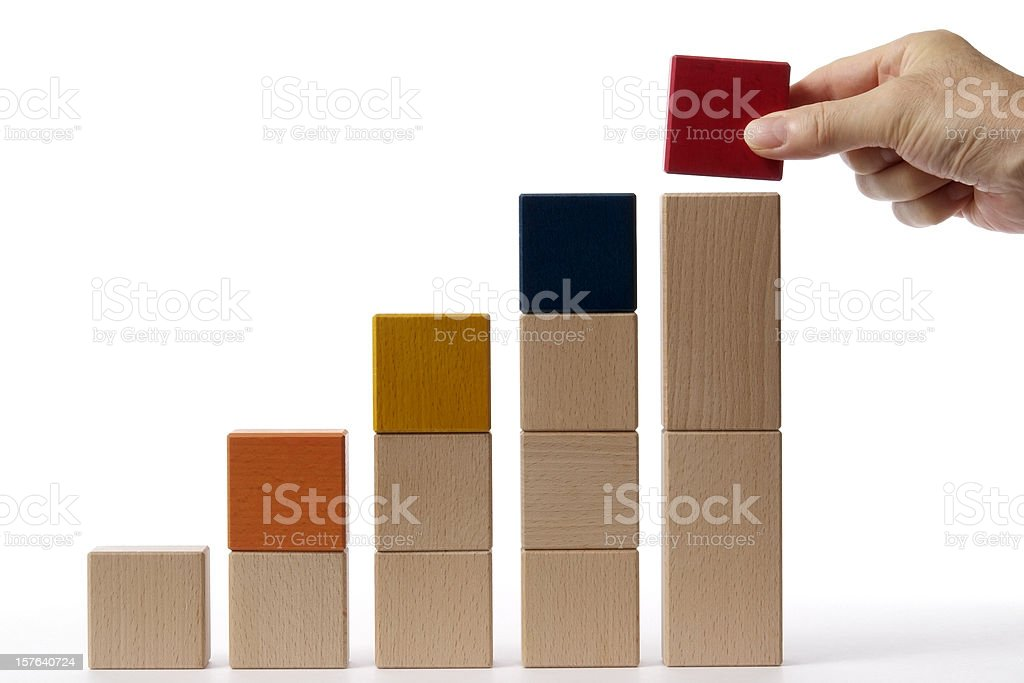 Isolated shot of bar chart from blocks on white background stock photo