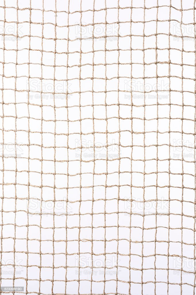Isolated shot of beige netting against white background stock photo