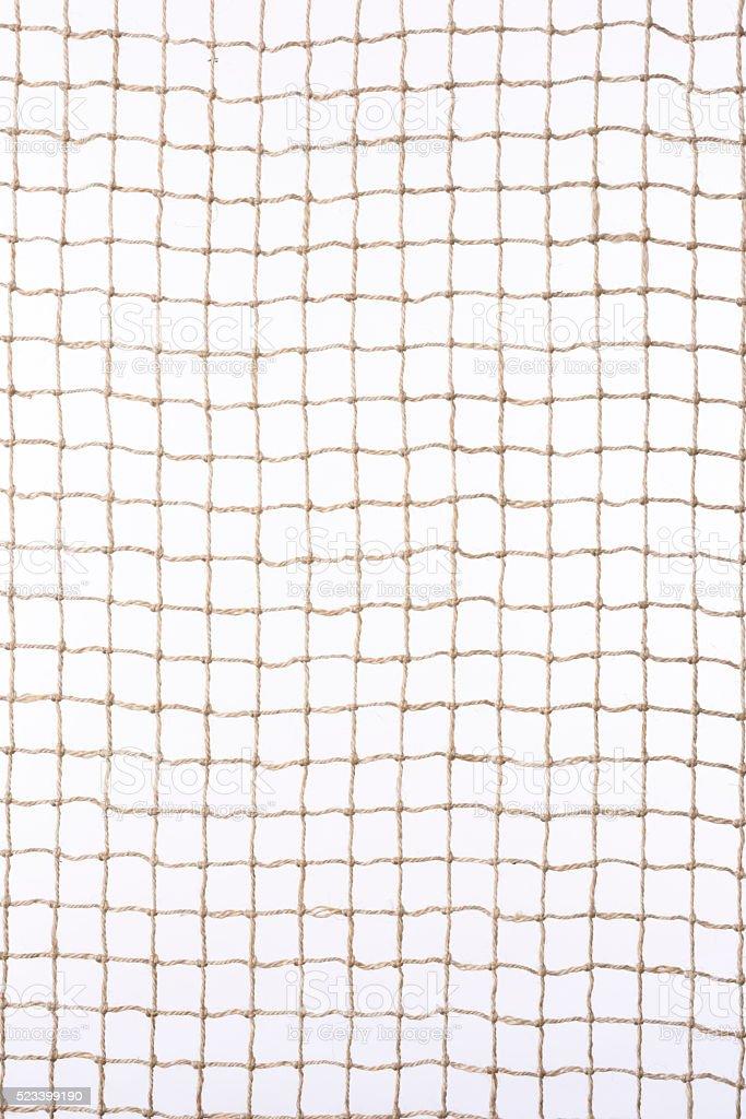 Isolated shot of beige netting against white background stock photo