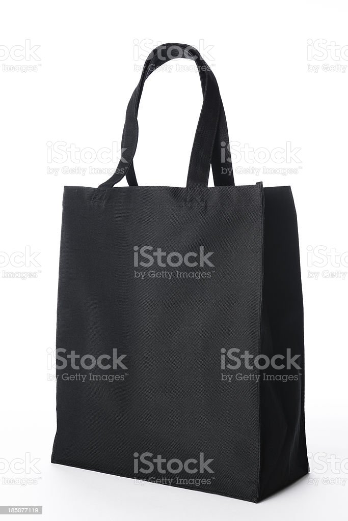 Isolated shot of black canvas tote bag on white background royalty-free stock photo