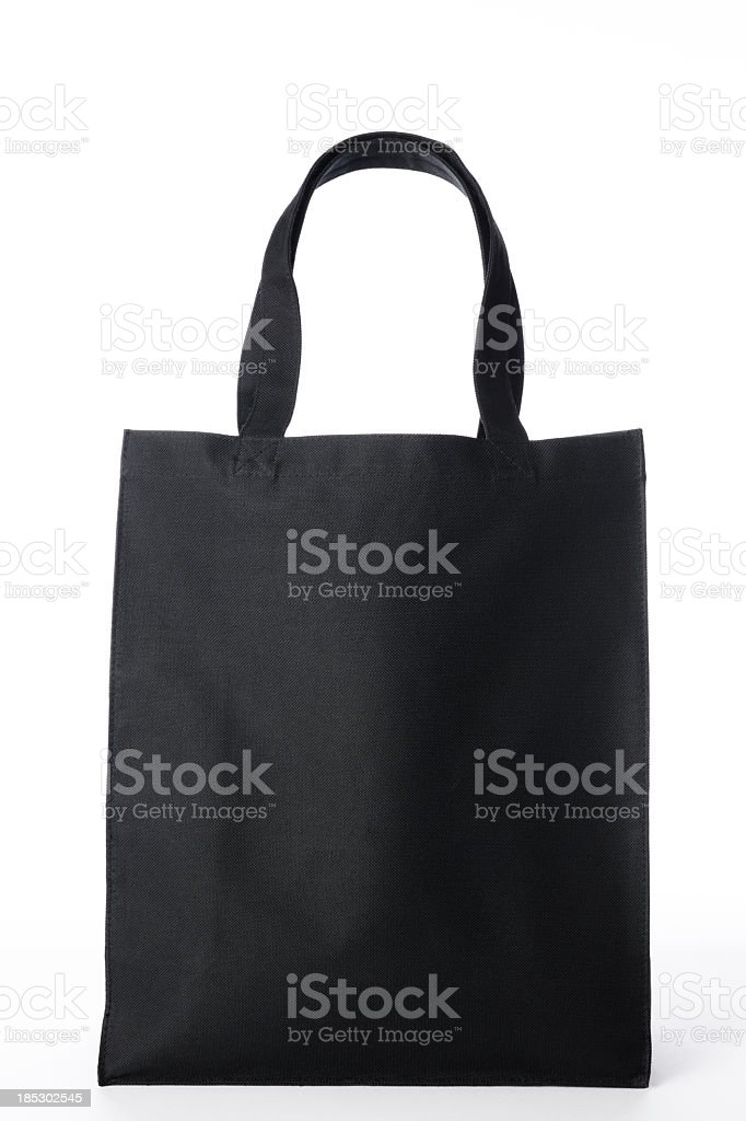 Isolated shot of black canvas tote bag on white background stock photo