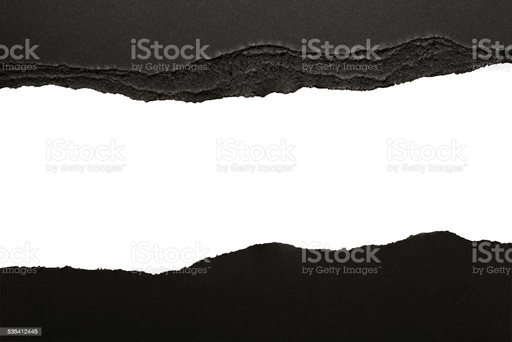 Isolated shot of black torn paper borders on white background stock photo