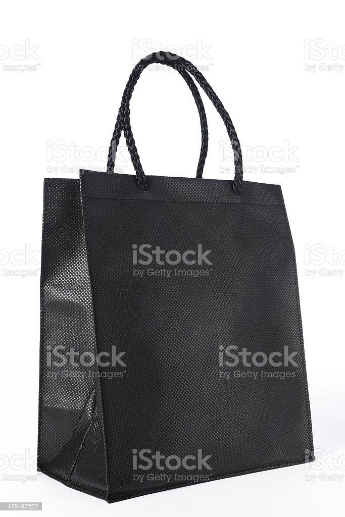 Isolated shot of blank black shopping bag on white background stock photo