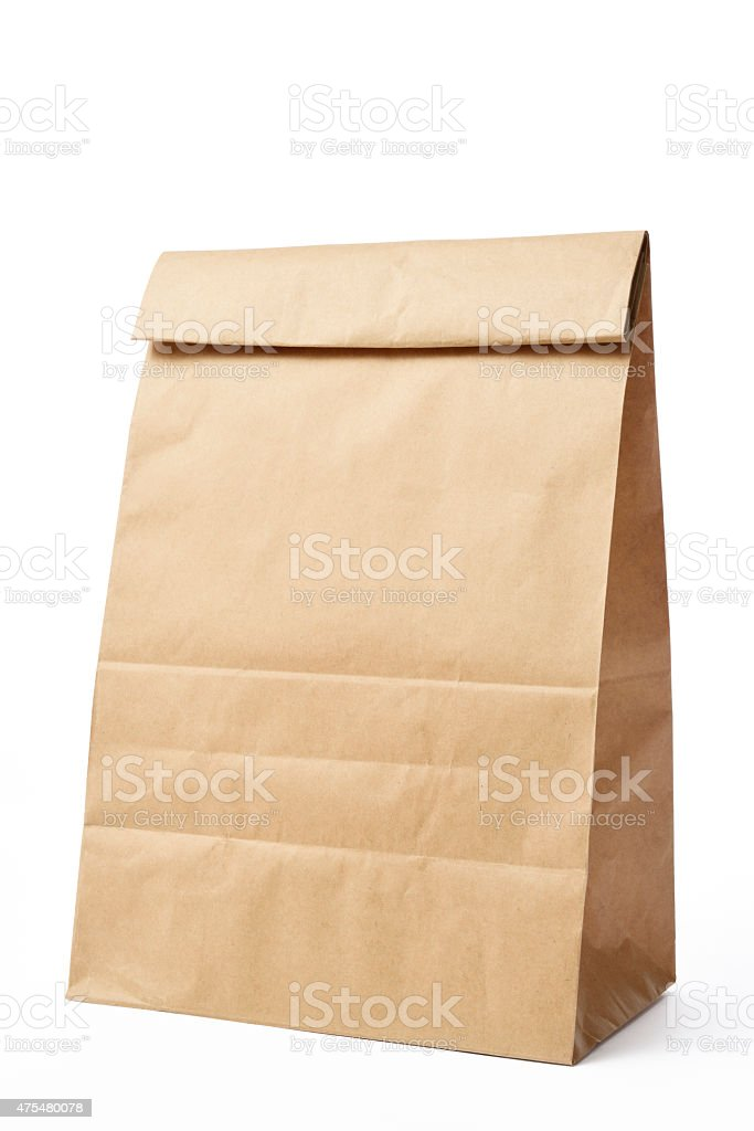 Isolated shot of blank brown paper bag on white background stock photo