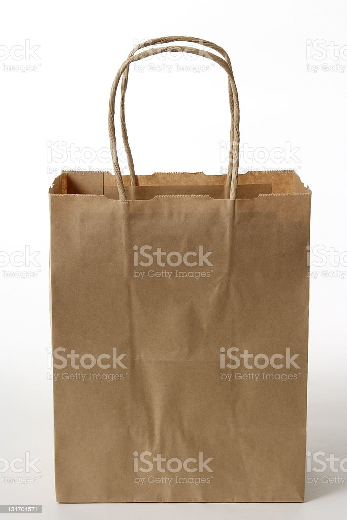 Isolated shot of blank brown shopping bag on white background stock photo
