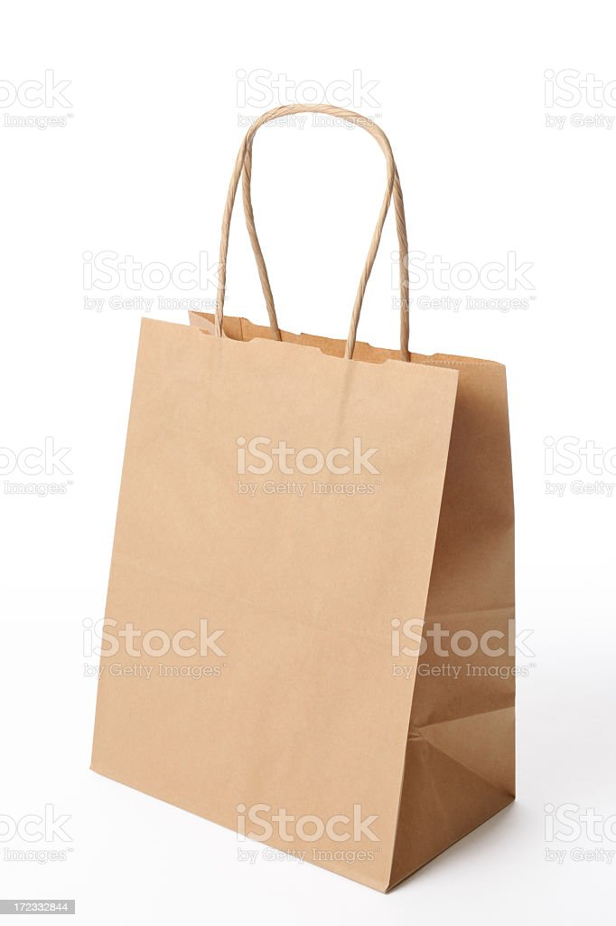 Isolated shot of blank brown shopping bag on white background royalty-free stock photo