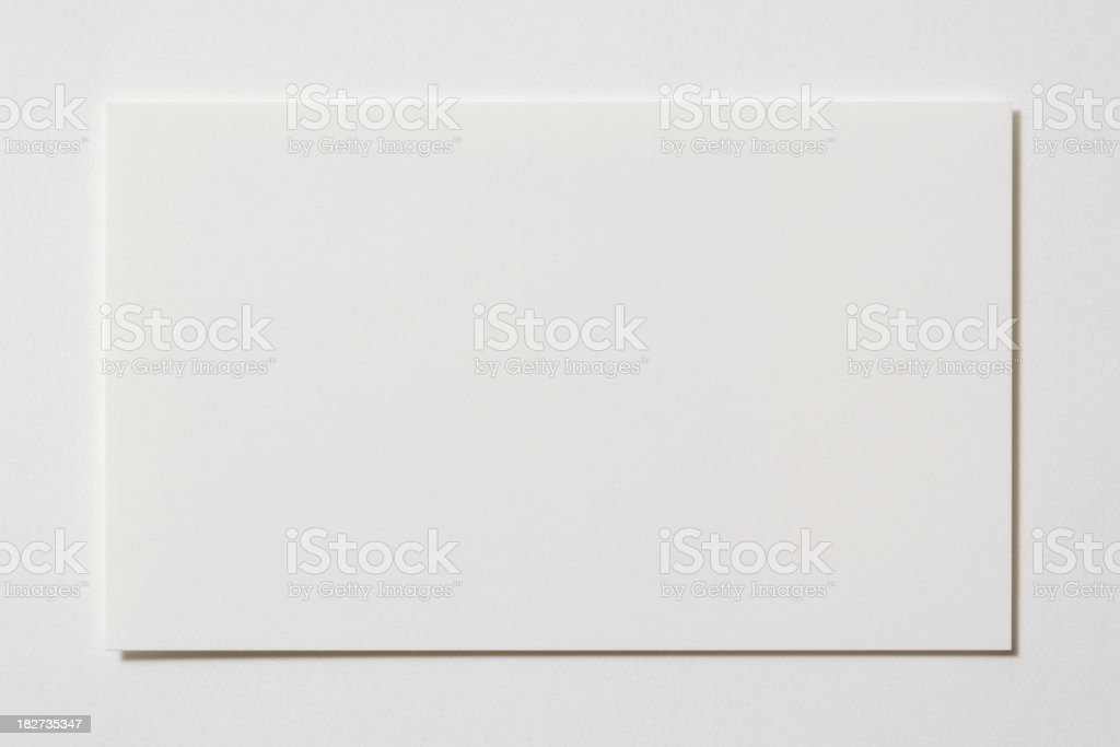Isolated shot of blank business card on white background stock photo