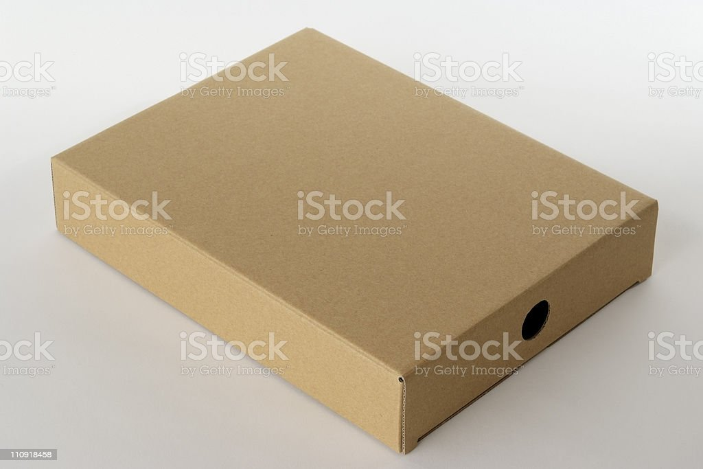 Isolated shot of blank cardboard box on white background royalty-free stock photo