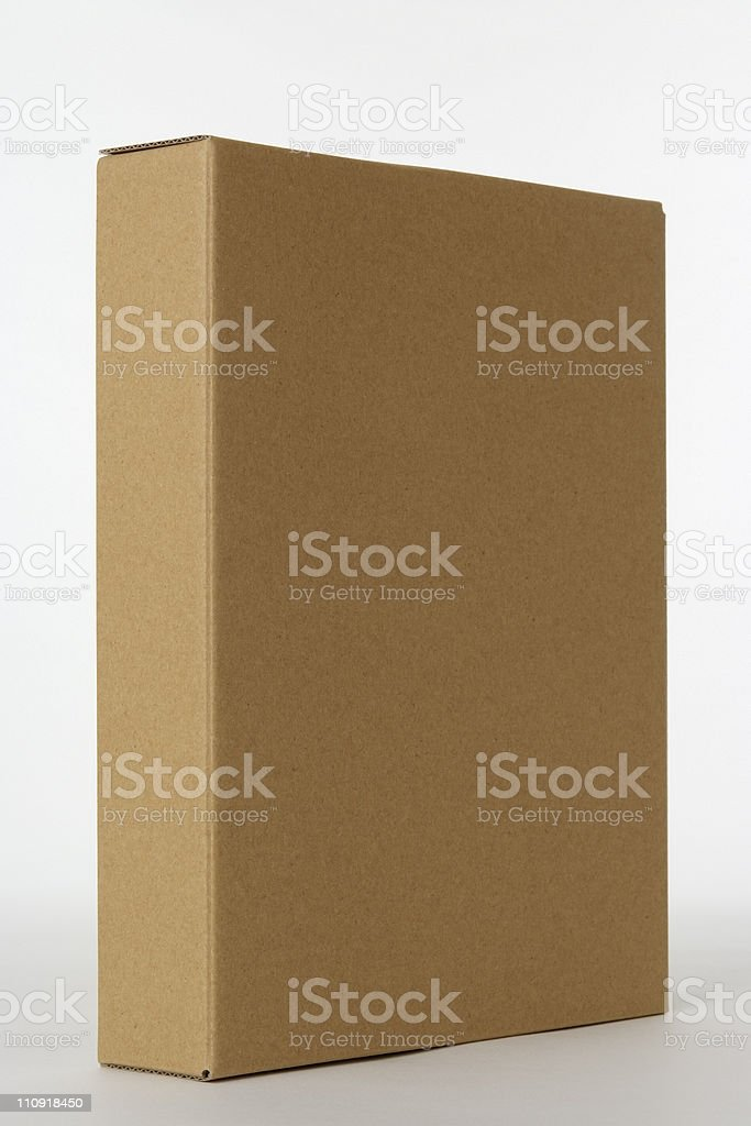 Isolated shot of blank cardboard box standing on white background royalty-free stock photo