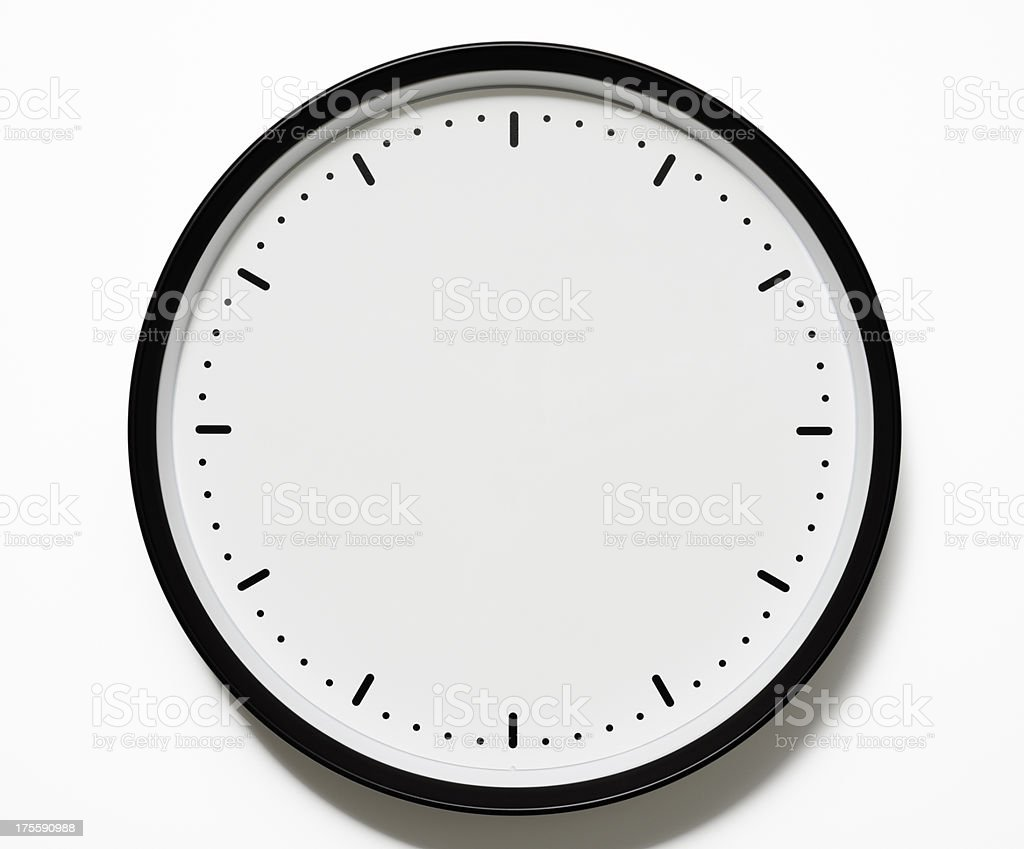 Isolated shot of blank clock face on white background stock photo