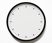 Isolated shot of blank clock face on white background