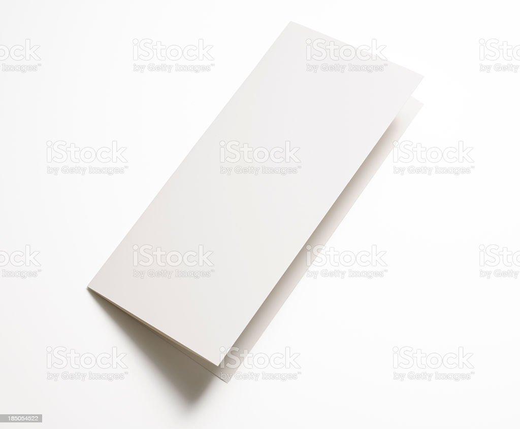 Isolated shot of blank folded paper on white background stock photo