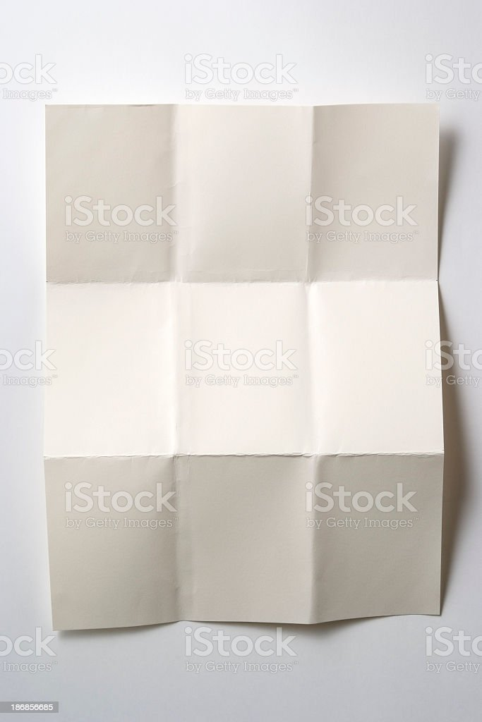 Isolated shot of blank folded paper on white background stock photo