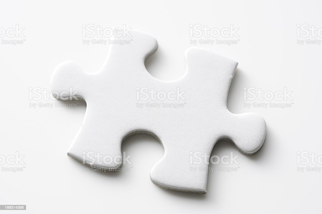 Isolated shot of blank jigsaw puzzles piece on white background royalty-free stock photo